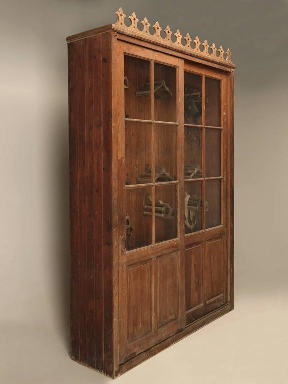 French tack cabinet from a vineyard in the South of France near the town of Bezier, circa 1880-1900. The sliding doors still have their handmade French wavy glass, and we have gone through an exhaustive sympathetic restoration, while being careful