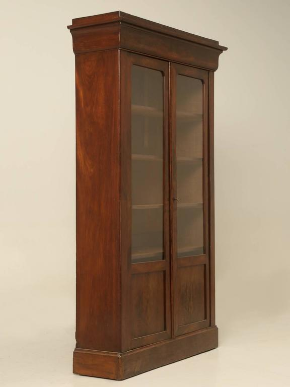 Antique French Louis Philippe style bookcase, in mahogany and in an unusual petite size, which should make it easy to fit almost anywhere. The French bookcase was received in such a nice original condition and other than tightening things up a bit,