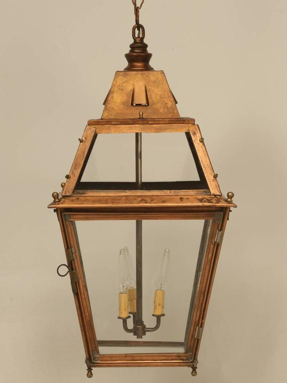 French copper lantern that can be used indoors or outdoors that our old plank restoration department took apart and rewired and adapted for the American market. This French copper lantern features three candelabra bulbs that will take a maximum of