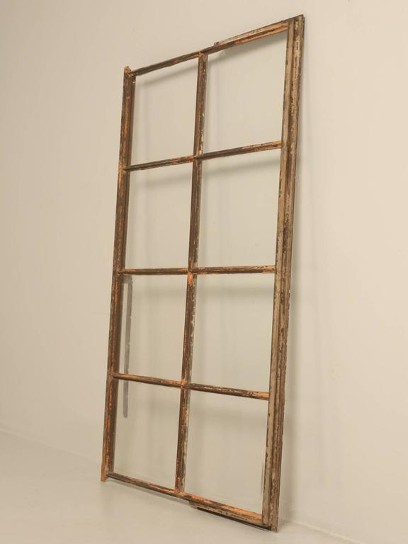 Great Industrial looking steel and cast iron window from a circa 1927 American factory. We have several available and they look great with mirrors installed as well.