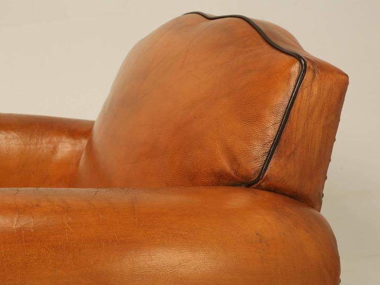 French Art Deco leather club chairs from the 1930s in a rich saddle tan color. The club chairs are 100% original leather with no prior repairs and other than tightening things up a bit underneath, they were in remarkable condition based on their
