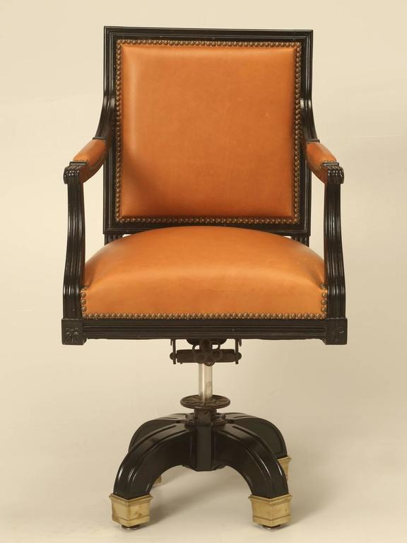 Vintage French Louis XVI style desk chair, done in an authentic French ebonized finish. The upholstery was just restored with glove soft leather imported from Italy, complete with old fashion horsehair padding, which lasts almost forever.