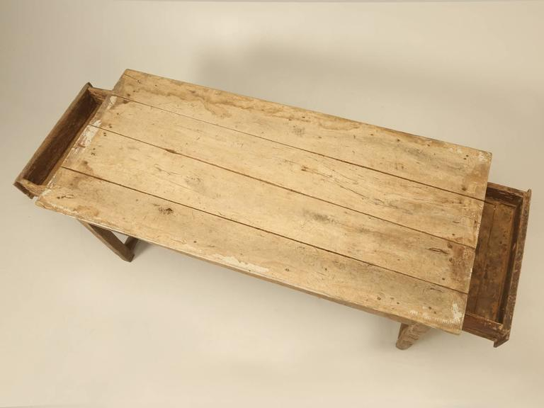 This antique Country French farmhouse dining table, really defines the definition of a barn find, but in this case, we are not thinking of an antique automobile, but rather a 300-year-old French dining table. Our Old Plank restoration department,