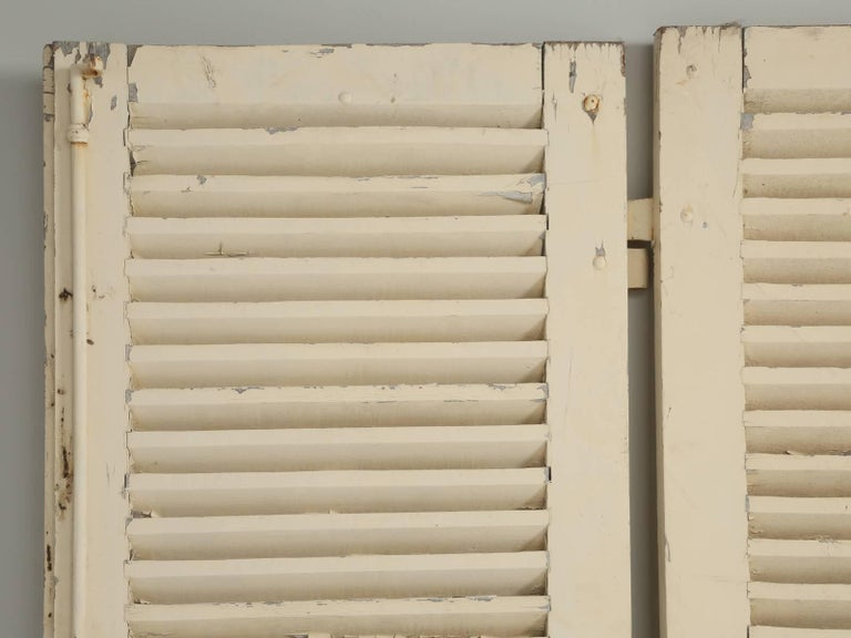 """Wonderful collection of antique French shutters, with their original hardware still intact. This particular set of antique French old painted shutters, are unusual, because of their width. Generally, you will find that the shutters are less than 12"""""""
