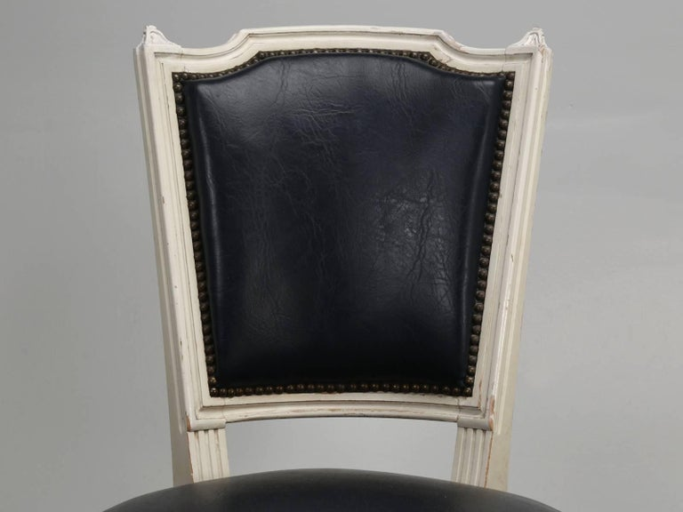Generally, when we find old French Louis XVI dining chairs, they are almost always in sets of six or sometimes, sets of eight side chairs. Rarely do you find six side with their matching Louis XVI style armchairs. This particular vintage set of