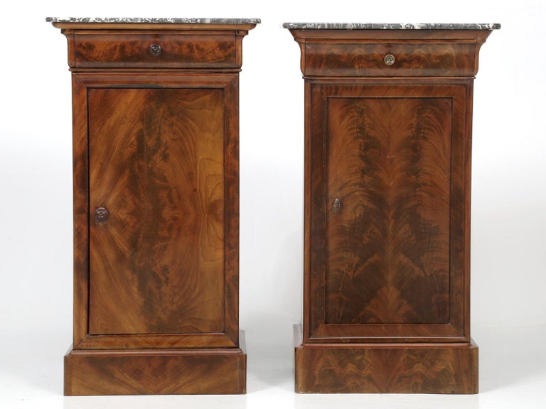 Antique French mahogany Louis Philippe style nightstands or in this case, end tables, since they are finished on all four sides. Our old plank restorer's, applied an old fashion French polish, that simply makes the grain of the mahogany nightstands