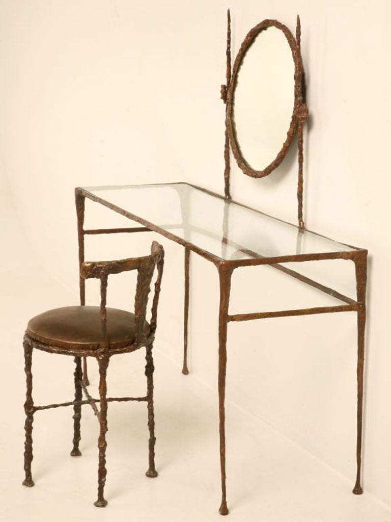 Solid bronze dressing table in the style of Alberto Giacometti with an optional chair that we have cast for us. Alberto Giacometti (1901-1966) was a Swiss sculptor, painter, draftsman, and print-maker extraordinaire and we have tried our best to