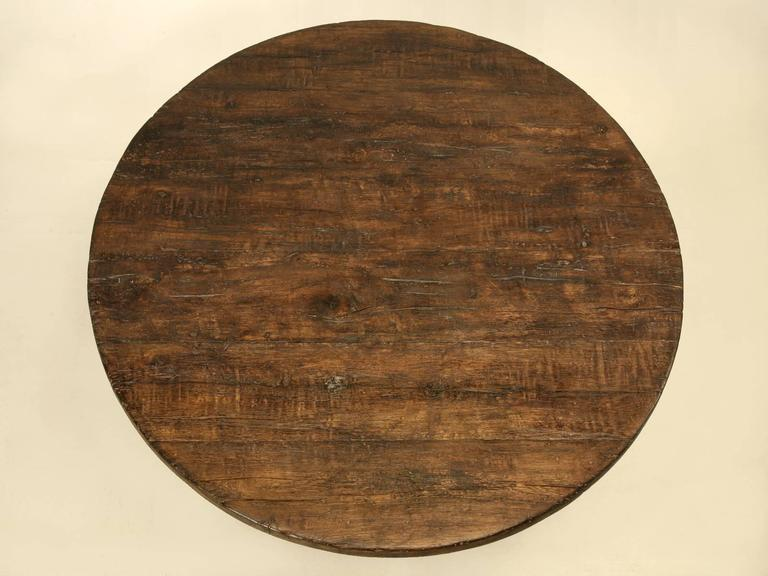 This table is a marriage of a circa 1840 Italian base and a reclaimed French white oak top. Our old plank finishers did their best to make the marriage as homonymous as possible. Even when you look very close, the top surface mirrors that of the
