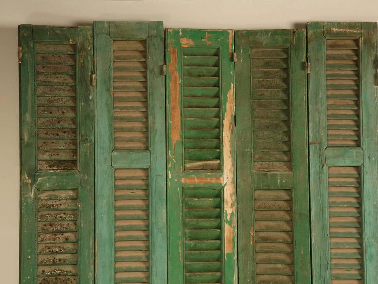 Found in Brittany and removed from a French chateau many years ago, this set of eight green shutters could be used for a myriad of different applications. From a simple room divider to a headboard there are endless possibilities. We have others