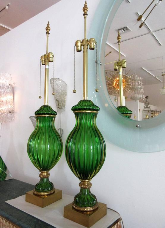 A large pair of emerald green Murano glass Marbro lamps. Measures: 48.5 H x 9.5.