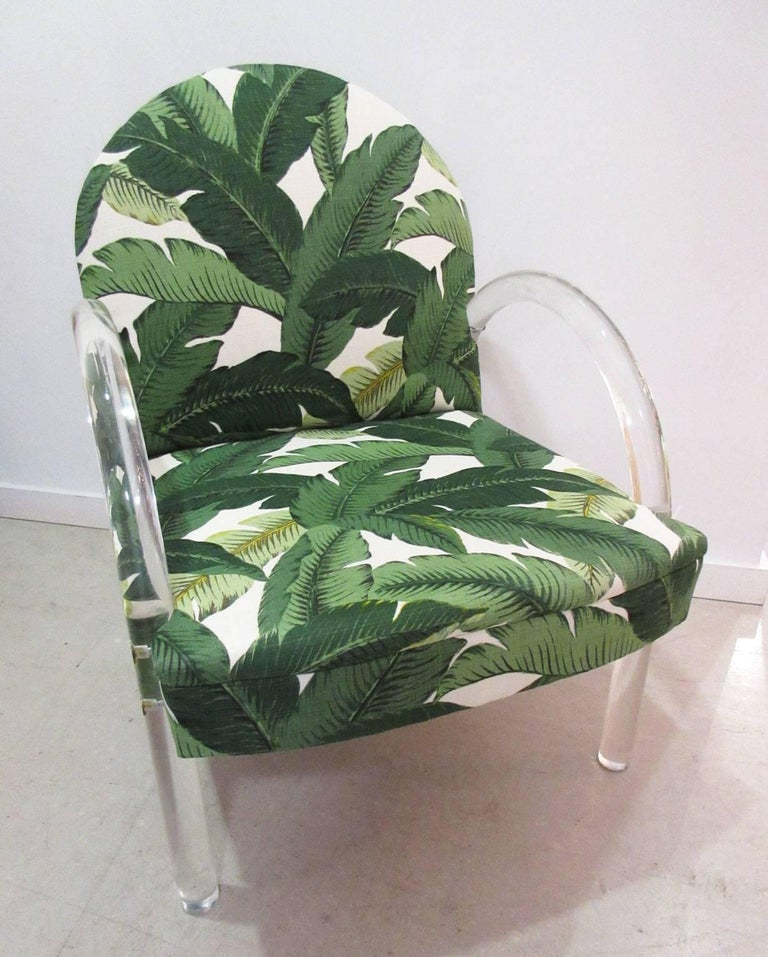 Pair of lion in frost lucite armchairs banana leaf print