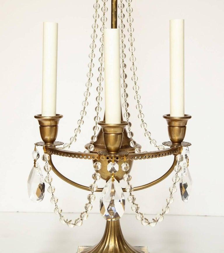 Hollywood Regency Pair of Brass Beaded Crystal Draped Candelabra For Sale