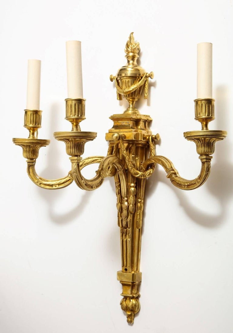 A pair of neoclassical gilt bronze sconces.