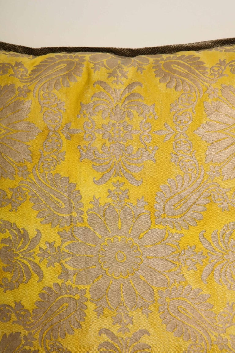 A pair of Fortuny fabric cushions in the Impero pattern, yellow and gold color way taffeta backing material, yellow and gold color way, the pattern, a 19th century Empire motif Newly made.   50 down/50 feather insert.