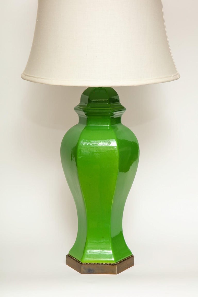 Apple green ceramic table lamps, of tapering form on hexagonal base with beaded trim