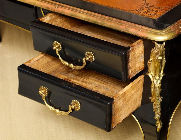A french louis xv style ebonized bureau plat in the manner of