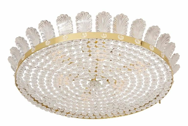 """The Decazes 31"""" beaded flush mount fixture, a large flush-mounted fixture, the underside formed by a steel frame grid with concentric rings covered by over-sized crystal rosettes with beaded center, insert encircled by polished brass frame having"""