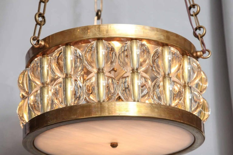 American A Two-Tiered Tambour Pendant Light With Chain  For Sale