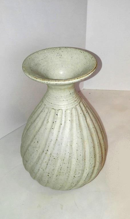 A Ceramic Vase From Thailand With White Glaze, Sprinkled With Dark Speckles  For Additional Visual