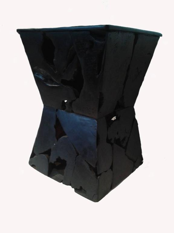 An hourglass shaped end table, carved out of strong black wood, from Indonesia. With its singular mosaic pattern, this original table is the perfect accent for modern, eclectic decor. Solid construction, polished top. Excellent vintage condition.
