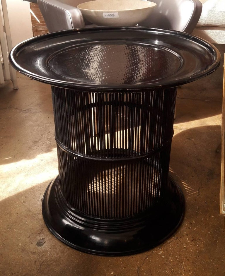A round black lacquered bamboo drum table with wide top from Thailand. Carved lattice design on surface top. Smooth lacquer finish.