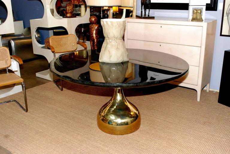 Goatskin (dark grey) round dining or center table with sculptural brass base (High gloss polyester resin filled finish).
