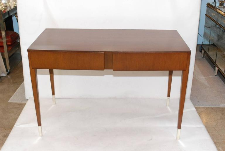 Rare 1940's walnut and oak two drawers and nickel-plated feet desk design by Gio Ponti, (1891-1979).  Gio Ponti, byname of Giovanni Ponti (born Nov. 18, 1891, Milan, Italy—died Sept. 15, 1979, Milan) Italian architect and designer associated with