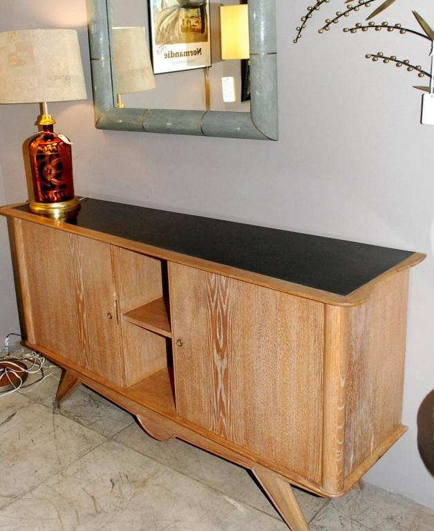 """French two doors cerused on oak and black laminate top sideboard. Please note: Depth is right side is 19"""" left side is 14""""."""