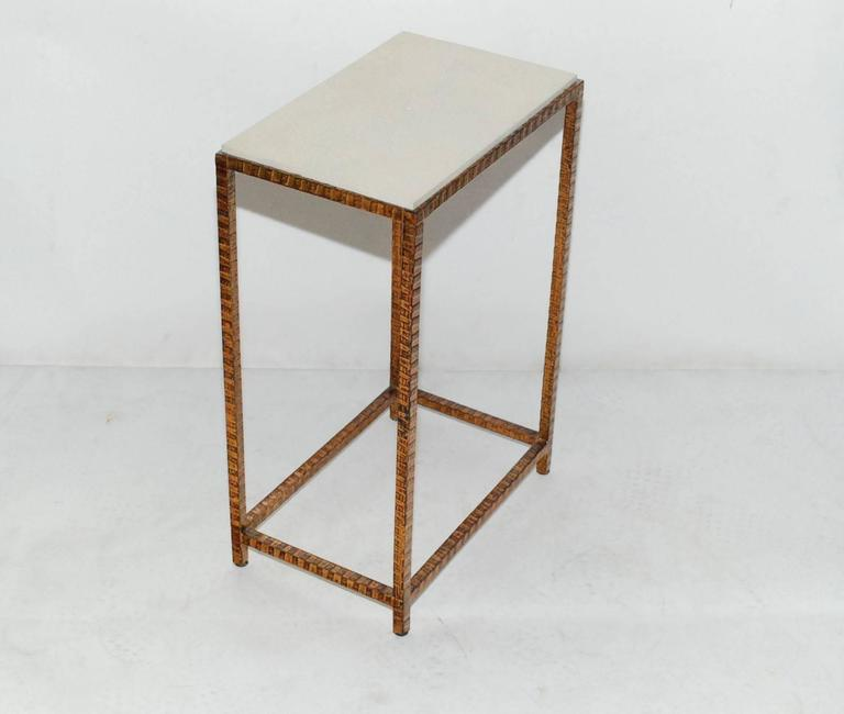 Pair of iron with copper finish side tables cover with white shagreen top.