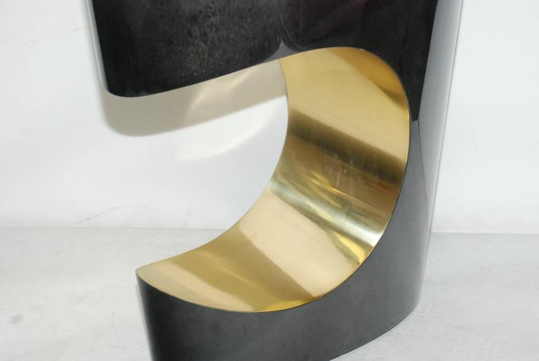 Pair of sculptural sofa tables cover with goatskin and brass. Parchment is in varying shades of charcoal. (High gloss polyester resin filled finish).