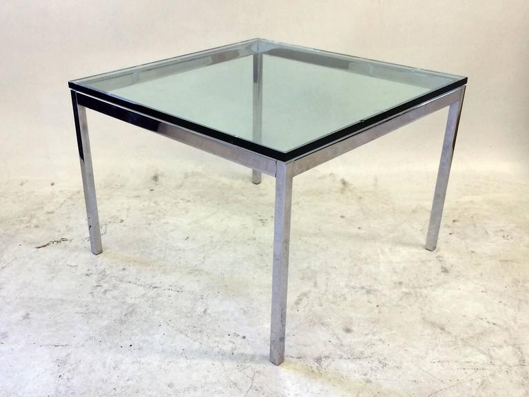 This glass top side table in chromed steel by Florence Knoll for Knoll retains its label Knoll.