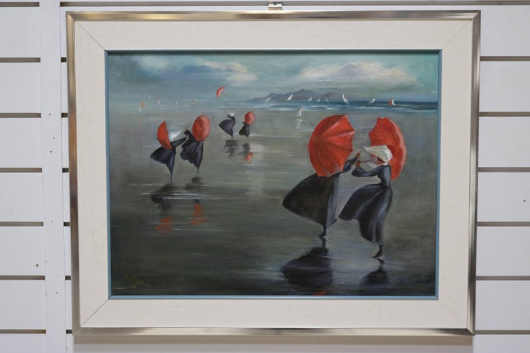 Oil painting depicting nuns holding red umbrellas by the sea shore. Signed and dated 1970 - artists name not clear but seems to read J. Wilson.