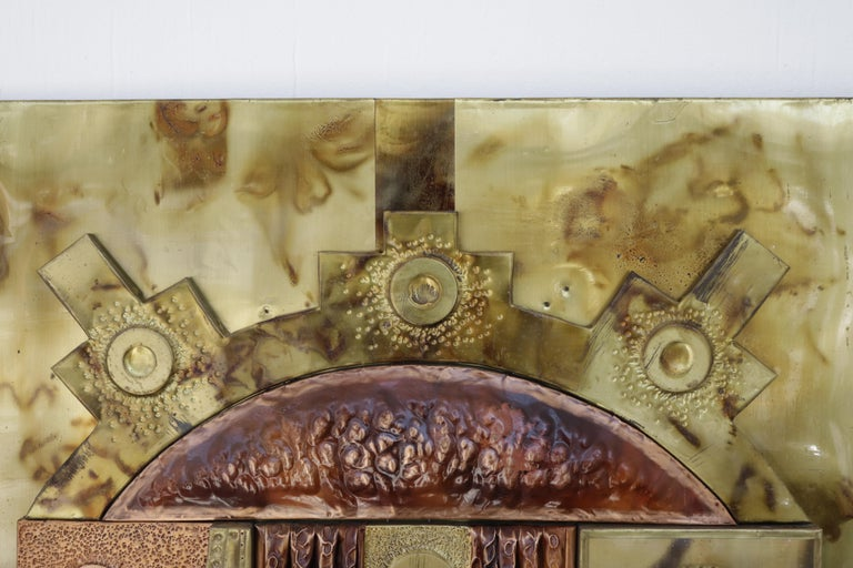 Brass and copper very decorative relief wall art.