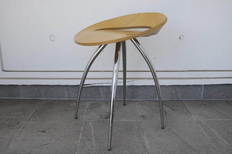 Set of chrome steel tubes and plywood stools by Magis. The Lyra stool 79 was designed by the Design Group Italia for renowned Italian furniture specialist Magis. Very comfortable laminated wood for the seat which follows the shape of the bottom