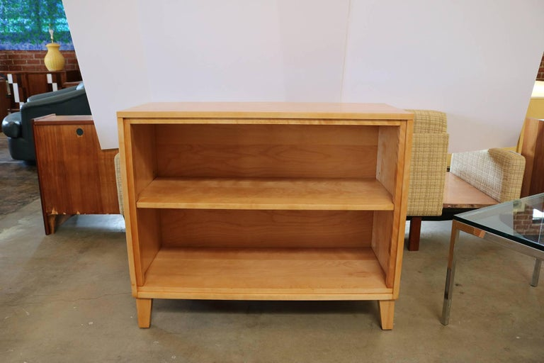 Newly small bookshelf made of solid maple by Russel Wright for Conant Ball. Russel Wright was an American industrial designer working during the early 20th century. He helped bring modern design to the North America from the late 1920s-1960s and