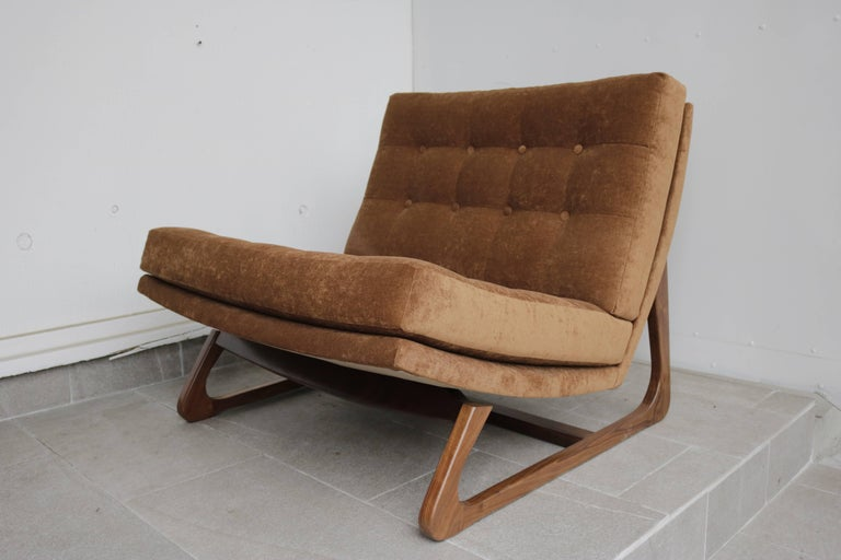 1960s Adrian Pearsall slipper chair with a sculptural teak base and tufted seat and back. Reupholstered in caramel tone chenille. Seat height is 12.5