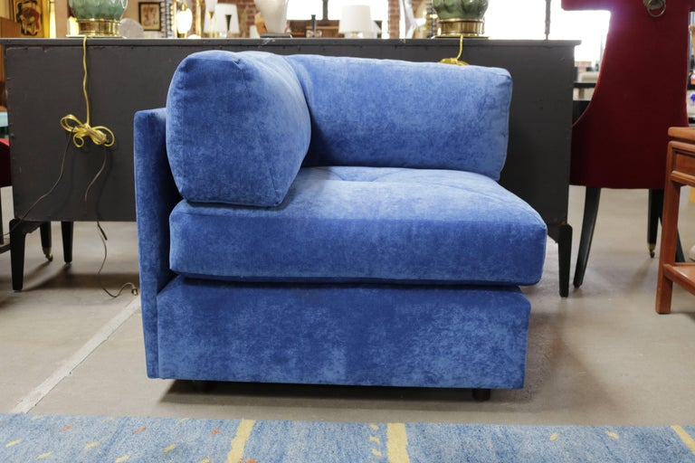 1960s two-piece lounge chair or settee by Milo Baughman, in beautiful blue velvet, on wheels. The ottoman conveniently opens up as storage. Milo Baughman designed the Articulate collection for James, Inc. of North Carolina, Thayer Coggin's first
