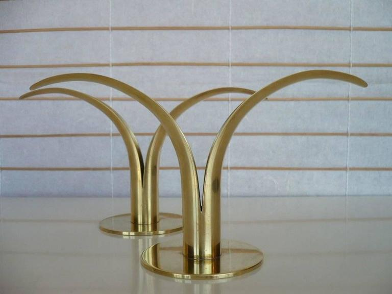 A pair of split blade leaf form solid brass candle holders made for Ystad Metal, Sweden, stamped with foundry makers mark and designers individual stamp above the Y logo.