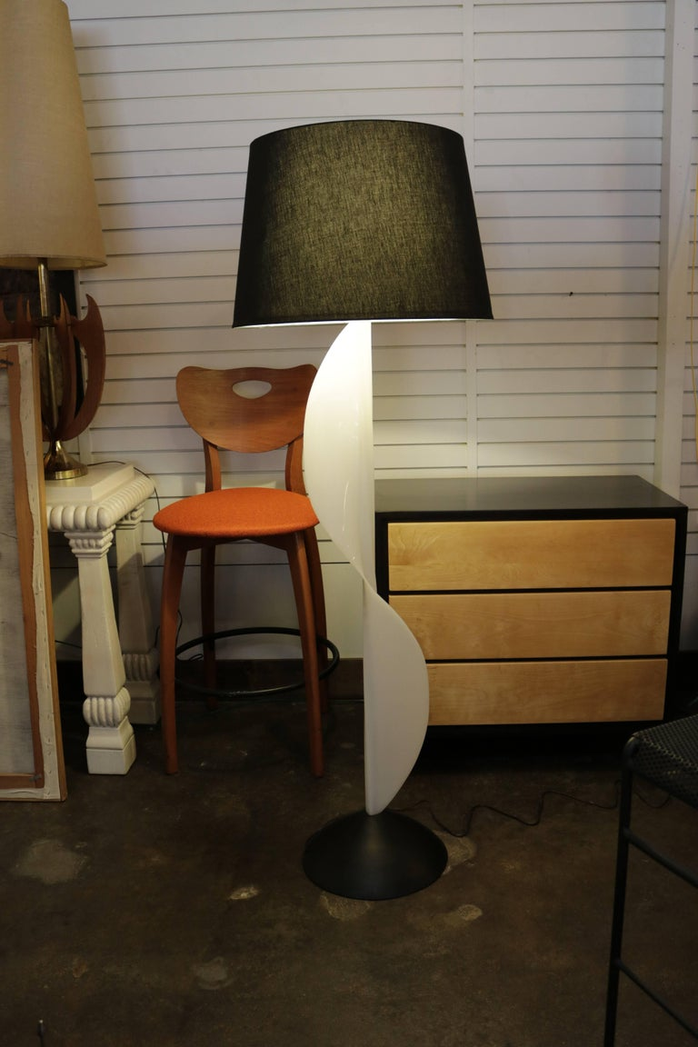 "Molded resin floor lamp made in Canada by Rougier. Lamp has an unique undulating, wave-like design. Measures 13"" in diameter across the base, 62"" H to top of finial or 50"" H to bottom of harp."