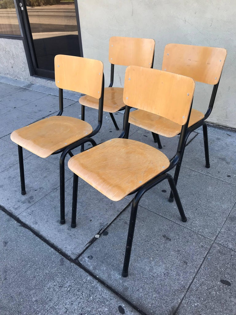 This chairs are made of maple plywood and black metal tubing.
