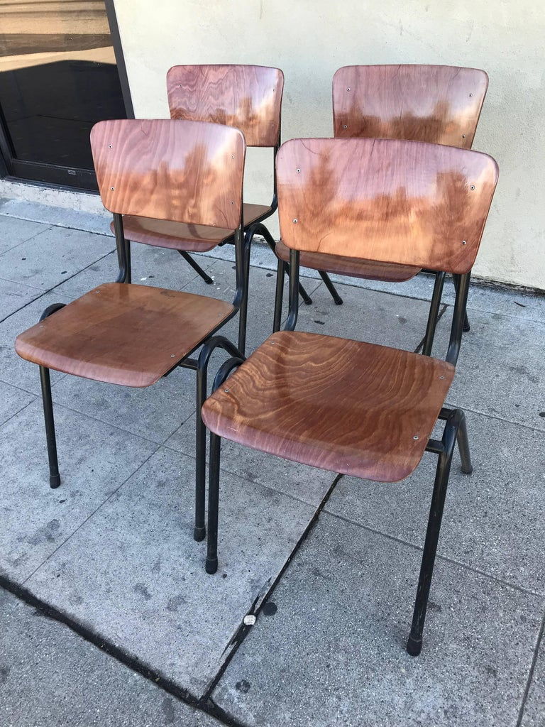 Four chairs in black metal tubing and beautiful bubinga plywood. The plywood grain is beautiful and rare of this kind of chairs.
