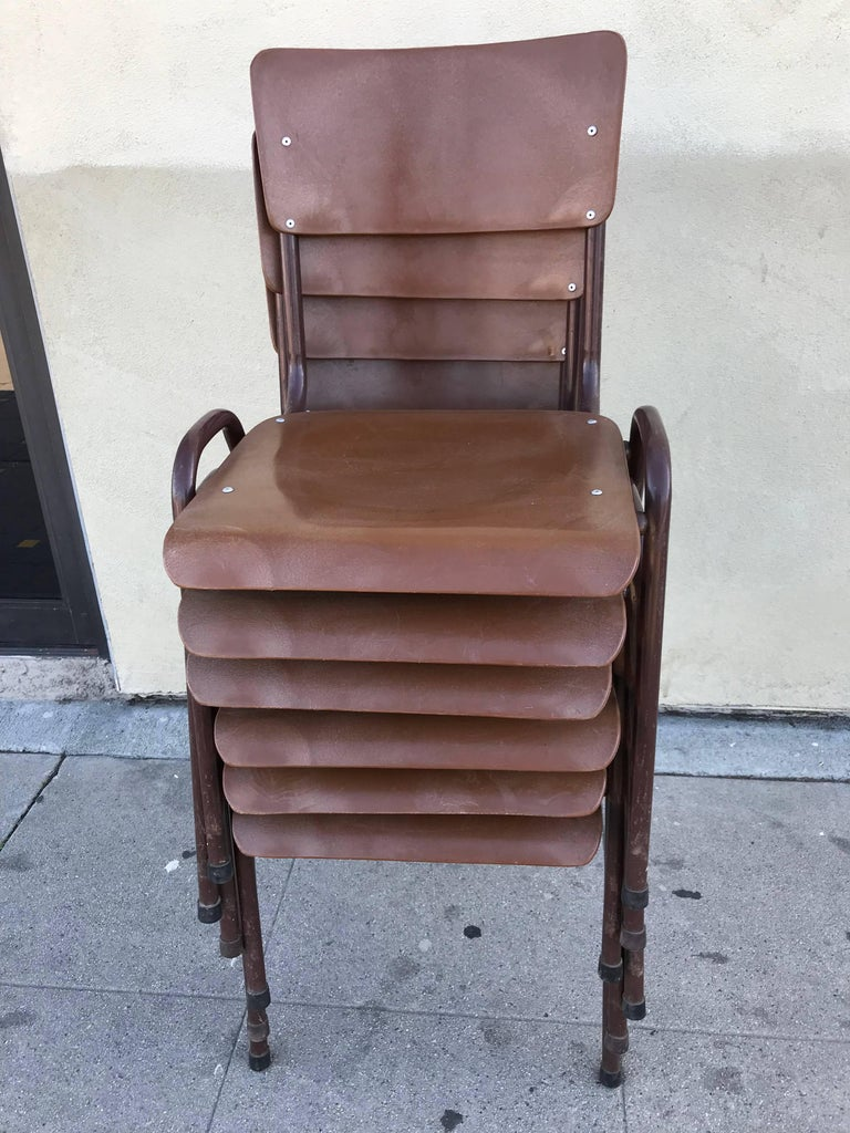 Set of six stackable school chairs in brown lacquer metal and strong brown plastic.