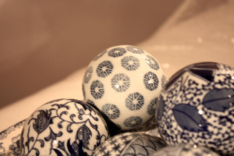 Blue and white ceramic bowl with decorative balls for sale