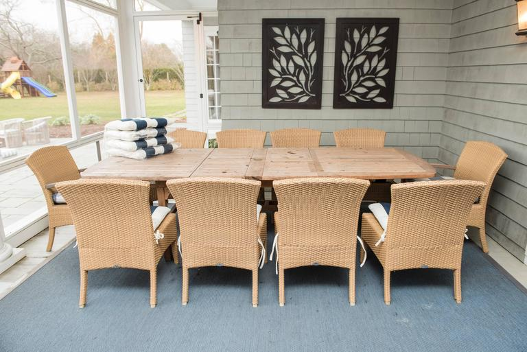 Teak dining table with ten chairs included.