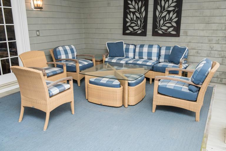 Coffee table has four pie shaped seats which are stowed under, four club chairs, sofa and two side tables.