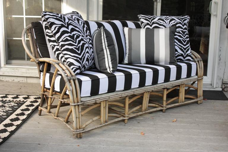 Vintage 1960's High Life-inspired outdoor three seat bent bamboo skeleton framed sofa with curved back and arms.  Bold bengal striped fabric with super-fast drying foam cushions.  Complete with all four supremely luxurious pillows.  Extremely