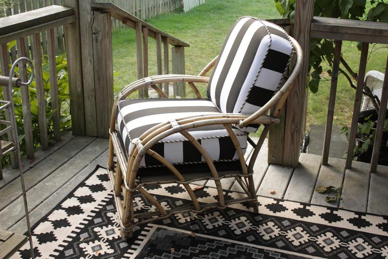 Fantastic 1960's Outdoor Sturdy bamboo framed modern style armchair with round back and arms.  Bent bamboo supports.  Bold Bengal striped outdoor fabric and twisted piping.  Firm and luxurious cushions.  You can see the quality!