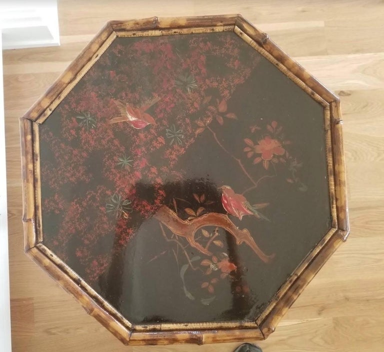Useful and decorative lacquered antique English chinoiserie side table with floral and avian motif. The frame is constructed from scorched bamboo, circa 1880s.
