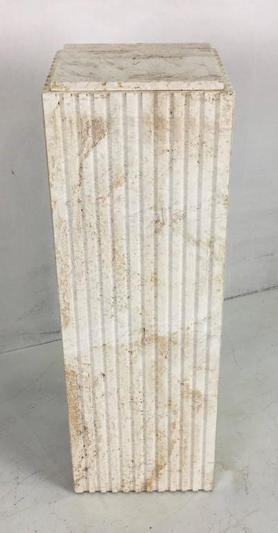 Beautifully rendered Italian made pedestal of unfilled travertine with fluted sides.