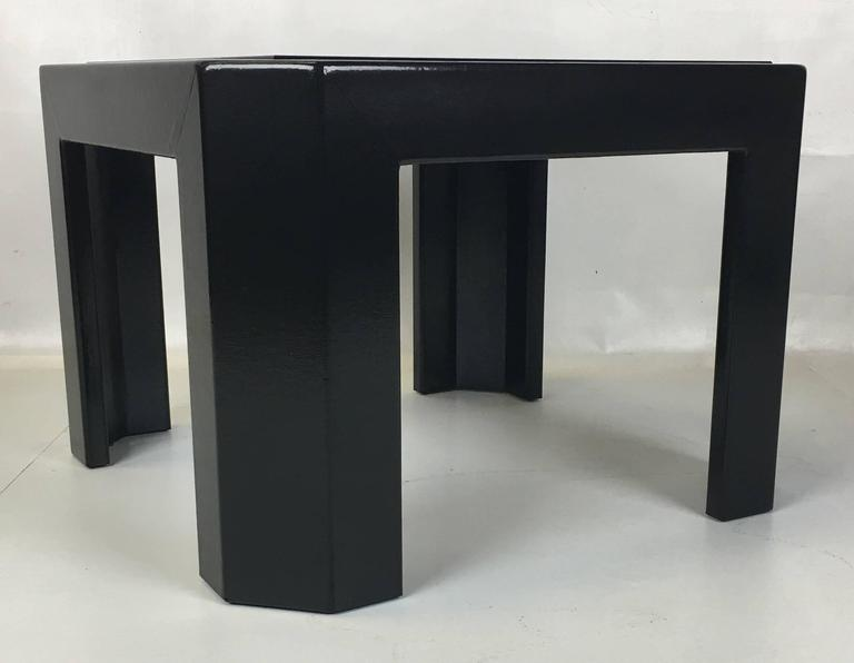Beautifully crafted black lacquered snakeskin side table with cut corners and inset smoked glass by Ron Seff.
